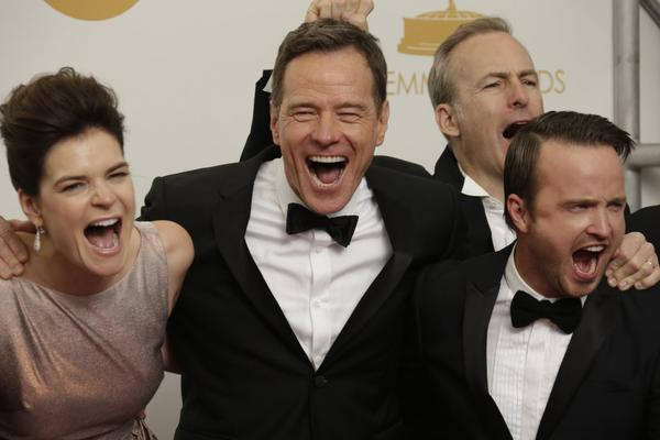 """Breaking Bad"" cast members Betsy Brandt, Bryan Cranston, Bob Odenkirk and Aaron Paul celebrate winning the best drama Emmy."