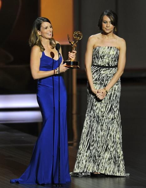 "Tina Fey, left, and Tracey Wigfield accept the award for outstanding writing for a comedy series for their work on ""30 Rock"" at the 65th Primetime Emmy Awards."