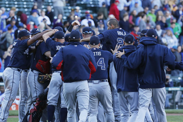 The Atlanta Braves rejoice after beating the Cubs and clinching the division title Sunday.