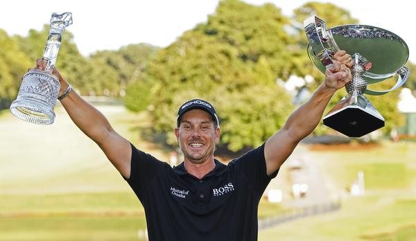 Henrik Stenson of Sweden poses with the Tour Championship and FedEx Cup trophies after winning both on Sunday.