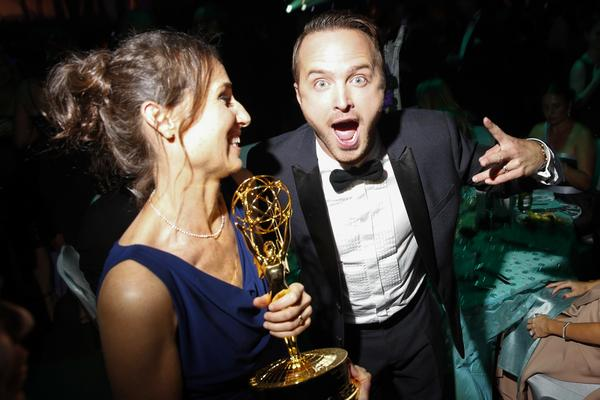 "Producer Kyra Thompson, left, who won an Emmy for reality competition program for ""The Voice,"" shares a moment with ""Breaking Bad's"" Aaron Paul."