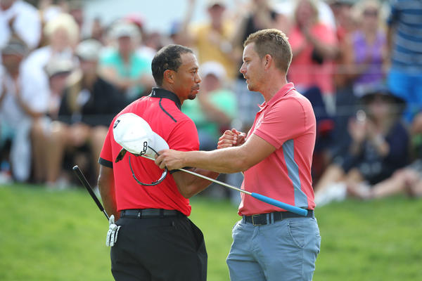 Tiger Woods shakes hands on the 18th green after the round with Henrik Stenson during the World Golf Championships - Bridgestone Invitational at Firestone Country Club.