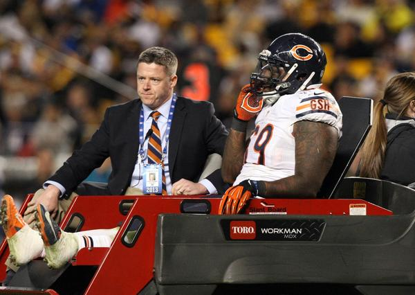 Chicago Bears defensive tackle Henry Melton (69) is carted off the field after being injured against the Pittsburgh Steelers during the second half at Heinz Field. The Bears won the game, 40-23.