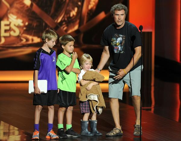 Will Ferrell and his children present the award for outstanding comedy series at the 65th Primetime Emmy Awards at Nokia Theatre on Sunday Sept. 22, 2013, in Los Angeles.