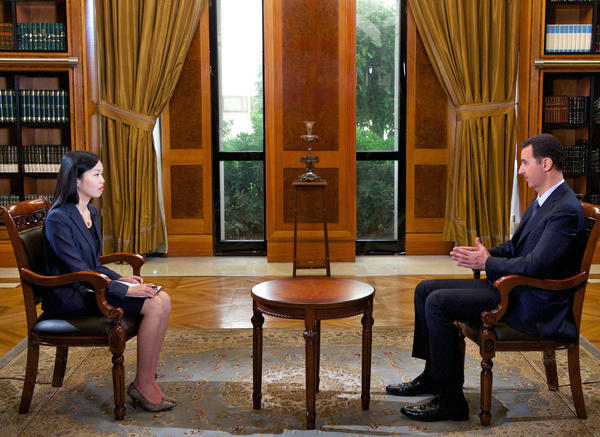 Syrian President Bashar Assad speaks during an interview with Chinese state television in Damascus.