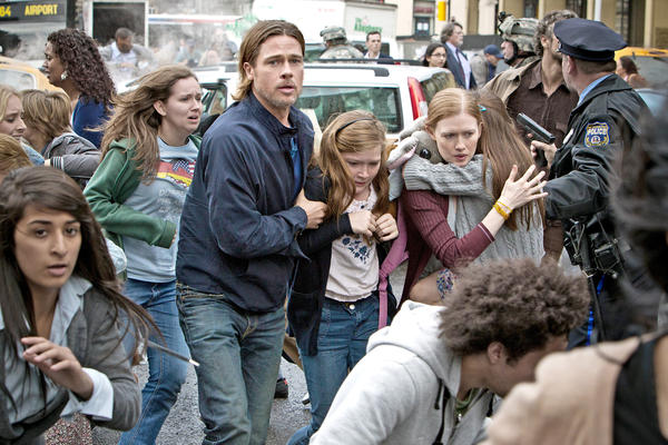 Left to right: Brad Pitt is Gerry Lane, Abigail Hargrove is Rachel Lane, and Mireille Enos is Karin Lane in WORLD WAR Z, from Paramount Pictures and Skydance Productions in association with Hemisphere Media Capital and GK Films.