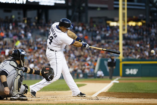 Sep 21, 2013; Detroit, MI, USA; Detroit Tigers third baseman Miguel Cabrera (24) hits a single in the first inning against the Chicago White Sox at Comerica Park.
