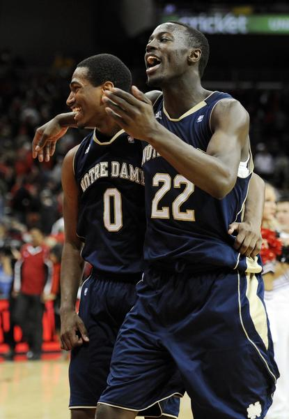 Notre Dame guard Jerian Grant (22) and guard Eric Atkins (0) celebrate following a double overtime with the Louisville Cardinals.