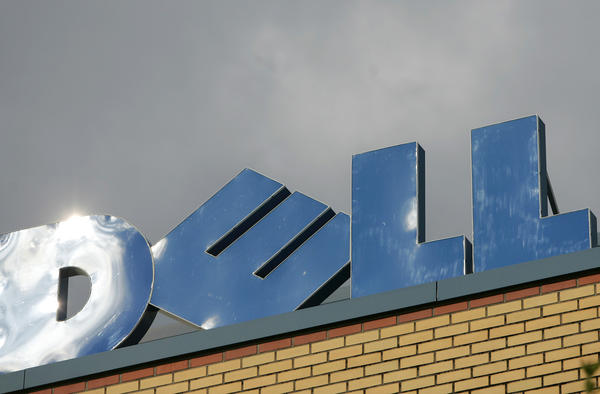 A Dell sign lies on top of the German headquarters of Dell Inc.