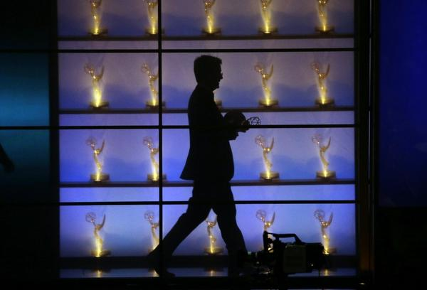 Stephen Colbert exits the stage after winning the Emmy for outstanding writing for a variety series.