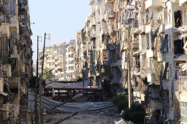 Heavily damaged buildings remain standing in an Aleppo neighborhood.
