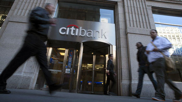 Pedestrians pass a Citibank branch in New York in a 2012 file photo.