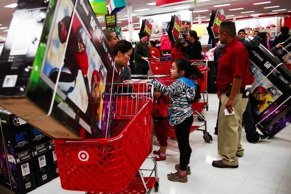Holiday shoppers looking for early Black Friday deals flood through the doors at a Target in Burbank, which opened at 9 p.m. on Thanksgiving in 2012.