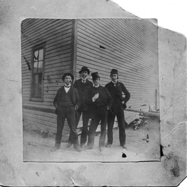 Highland Park High School Class 1898. Left to right: Ira Hole, George Millard, Frank McCaffrey, Newmn Finney.