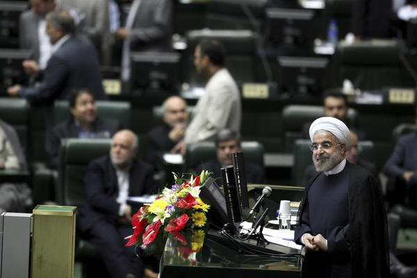 Iranian President Hassan Rouhani, shown in this file photo from an Iranian parliamentary address last month, plans to take his case for sanctions relief to the U.N. General Assembly in New York this week.