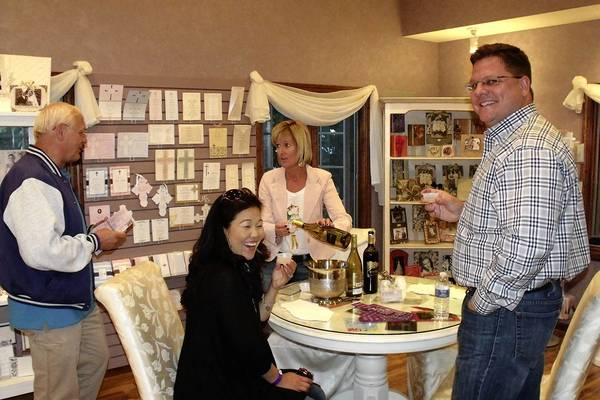 Guests enjoyed a wine sample at The Paper Spot during the inaugural wine walk, Wined-ing through Historic Downtown Frankfort.