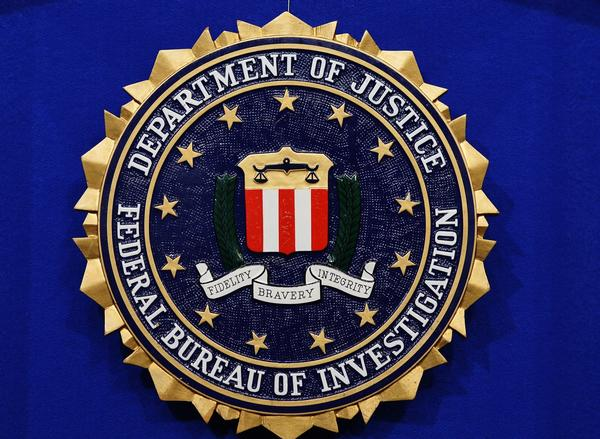 The Federal Bureau of Investigation (FBI) seal is seen on the lectern following a press conference.