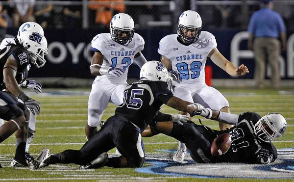 Old Dominion University's Andrew Everett, right, recovers the ball after an onside kick attempt from The Citadel's Eric Goins, right, during Saturday's game at Ballard Stadium.