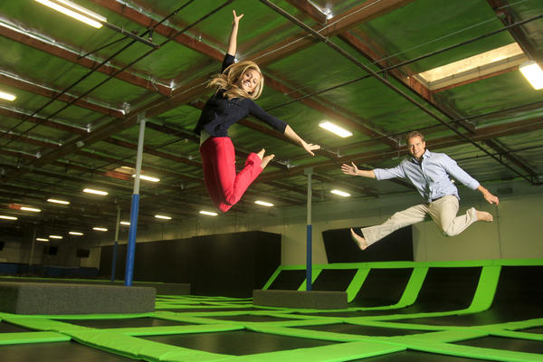 Owners Kiele Iverson and Pete Bradshaw pose for a portrait at their indoor trampoline park called Get Air Surf City in Huntington Beach.