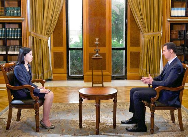 Syrian President Bashar Assad is interviewed by Chinese state television in Damascus. He warned that rebels would try to block international inspectors' efforts to catalog and impound the country's chemical weapons stockpile. (Syrian Arab News Agency / September 24, 2013)