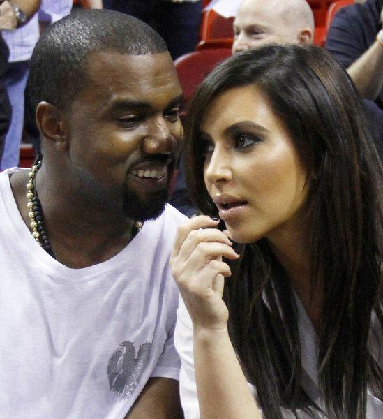 Kim Kardashian with Kanye West at a Miami Heat-New York Knicks game in Miami.