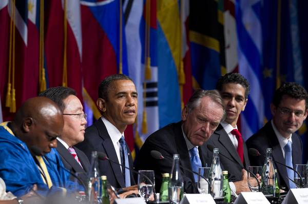 President Obama with, from left, Maina Kiai, United Nations special rapporteur; Tsakhiagiin Elbegdorj, president of Mongolia; Jan Eliasson, U.N. deputy secretary-general; Alejandro Gonzalez Arreola of the Open Government Partnership; and Douglas Rutzen, president of the International Center for Not-for-Profit Law take part in an International Civil Society event in New York on the eve of the U.N. General Assembly.