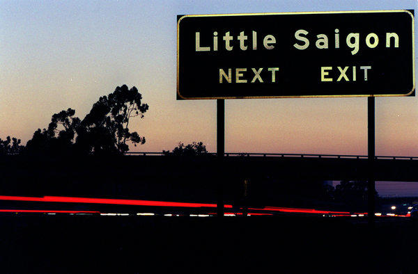 Freeway exit sign for Little Saigon in Westminster, where the police chief said he would mount an outreach campaign to reassure immigrant residents and businesses that law enforcement officials are trustworthy.