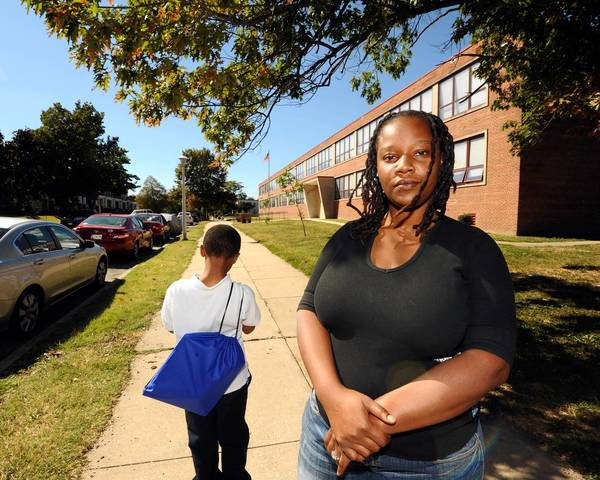Tameka Pridget and her son are plaintiffs in a lawsuit against the school system that alleges it is failing to provide federally mandated services to homeless families.