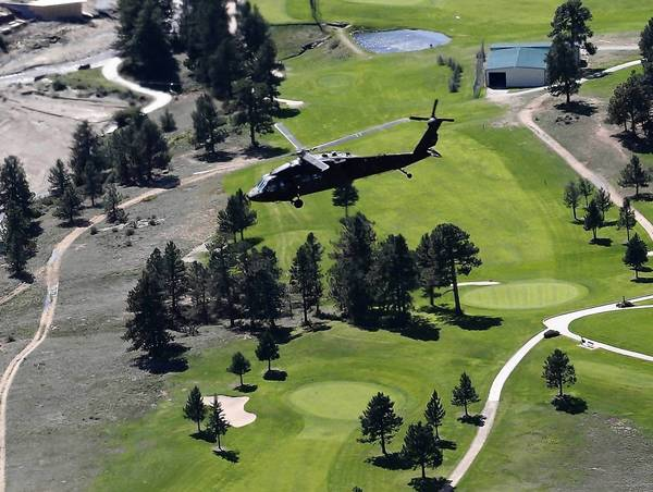 A helicopter carrying Vice President Joe Biden provides a view of flood damage near Estes Park, Colo.