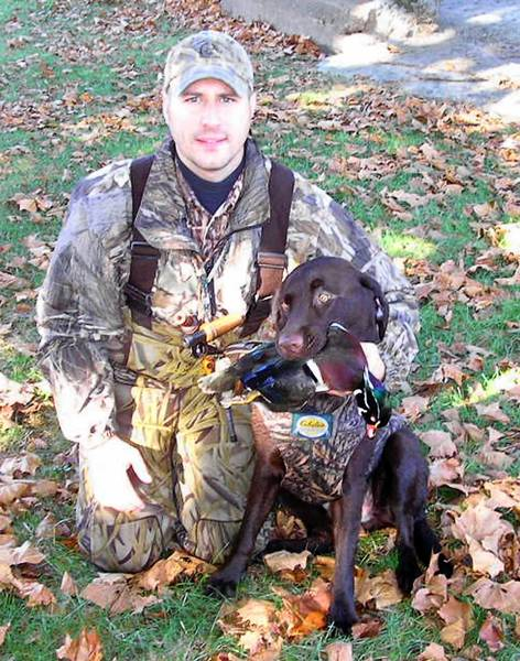 David 'JR' Felchock of Schnecksville and his 7-year-old chocoalte Labrador retirever Cooter. Felchock has been named chairman of the state chapter of Ducks Unlimited.