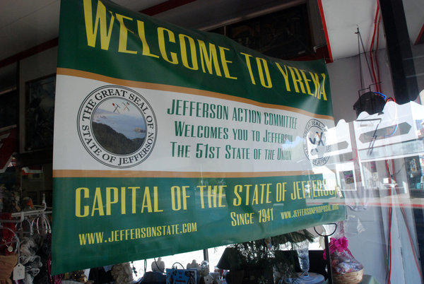A banner welcoming visitors to the State of Jefferson hangs in the window of a downtown business in Yreka, Calif., home to one of several secession movements across the country.