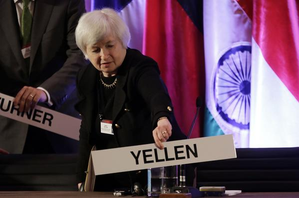 Federal Reserve Vice Chairwoman Janet L. Yellen places her name card at her seat at the International Monetary Conference in Shanghai.