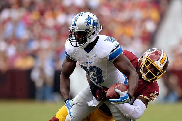 Nate Burleson of the Detroit Lions is tackled by David Amerson of the Washington Redskins last Sunday.