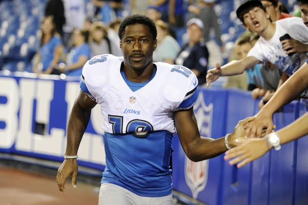 Detroit's leading receiver, Nate Burleson, seen in August, broke his arm in a car accident early Tuesday.