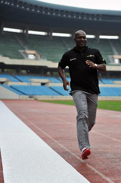 Disgraced drugs cheat Ben Johnson poruns next to a 100 meters long anti doping petition (L) displayed on the sixth lane of a running track at the Seoul Olympic Stadium on September 24, 2013, 25 years to the day of his steroid-assisted 100m final victory. The Canadian sprinter revisited the site of his stunning triumph and downfall to bring an anti-doping message for a sport still struggling to rid itself of banned substance use. AFP Photo / KIM DOO-HOKIM DOO-HO/AFP/Getty Images ORG XMIT: