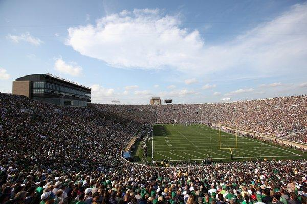 Two brothers in San Diego admit defrauding sports fans with phony tickets to football games, including home games of the Notre Dame Fighting Irish.