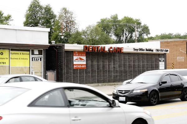 Motorists pass by a vacant storefront business on Oakton Street in Des Plaines. City officials hope to attract new business with a proposal to streamline the business licensing process.