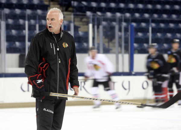 Blackhawks head coach Joel Quenneville runs a training camp practice at Notre Dame.
