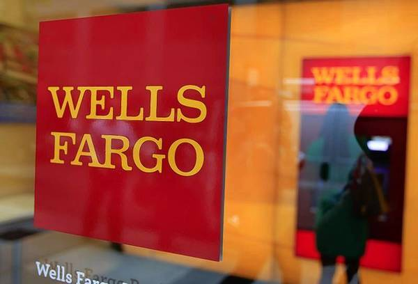 A Wells Fargo sign is seen outside a banking branch in New York.