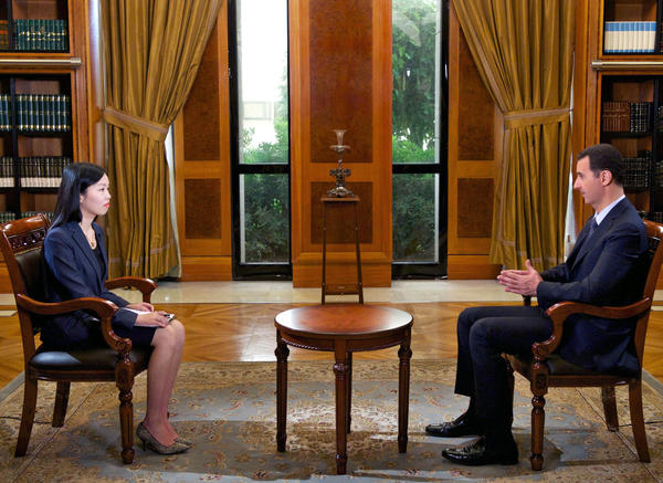 Syrian President Bashar Assad gives an interview in Damascus to China's CCTV.