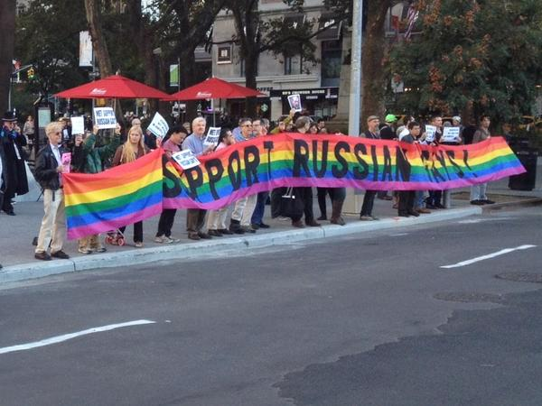 """Gay-rights advocates held a rainbow banner outside Lincoln Center that read, """"Support Russian gays."""""""