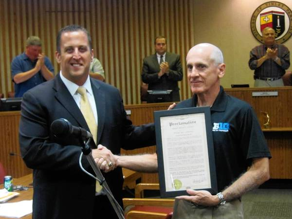 Illinois Sen. Mike Hastings, left, recognizes Bill LeMonnier for his work as a college football referee at the Sept. 17 Tinley Park Village Board meeting.