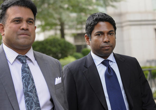 Rengan Rajaratnam, right, founder of Sedna Capital Management LLC and younger brother of imprisoned hedge-fund founder Raj Rajaratnam, exits federal court with his attorney Vinoo Varghese in July. Rengan was charged for his alleged part in an insider trading scheme tied to his brother's fund the Galleon Group LLC.