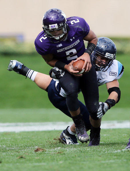 Northwestern Wildcats quarterback Kain Colter (2) is tackled by Maine Black Bears linebacker Zachary Hume (44) during their game last Saturday.