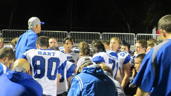 St. Francis Coach Greg Purnell talks to players during the team's loss to Montini.