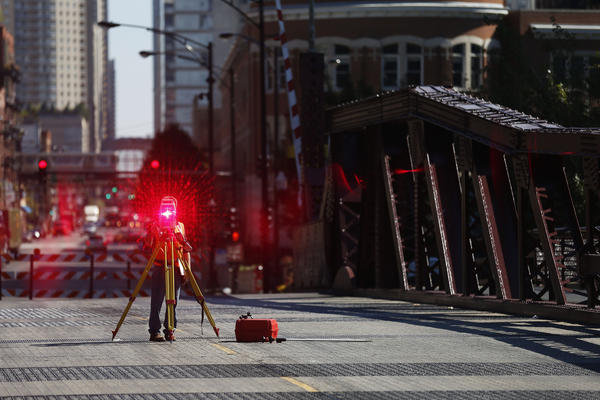 A worker on the Grand Avenue bridge in Chicago on Tuesday. Emergency repairs are forcing a two-week shutdown of the bridge over the Chicago River's North Branch. The 100-year-old bridge closed after 7 p.m. Monday and will stay closed through Oct. 7, the Chicago Department of Transportation said.