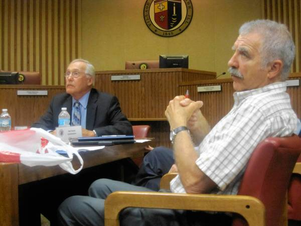 Term Limits Commission Chairman Kent Slater and commissioner John Perry listen as Tinley Park resident Steve Eberhardt, whose political organizing spurred the commission's creation, addresses the panel