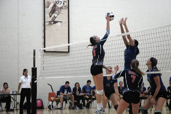 The Naperville North Huskies fight for a point against St. Charles North at the Wheaton Classic volleyball tournament on Saturday.