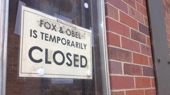 A sign on the door of Fox & Obel on Tuesday.