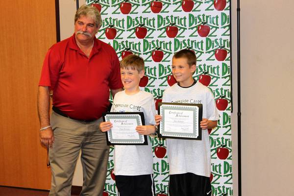 Plainfield Community Consolidated School District 202 School Board President Roger Bonuchi recognized Tripp Morrison and Max Molinari, both 11, for their support of the Creekside Cares backpack program.